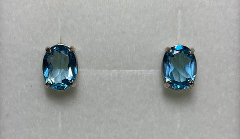 Sterling Silver 8X6Mm Oval Blue Topaz Claw Set Stud Earrings