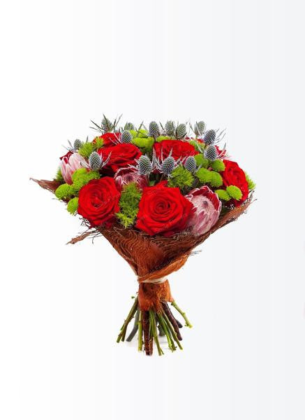 A classical flower bouquet with red roses