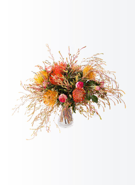 A bouquet of leucospermums and miniature roses.