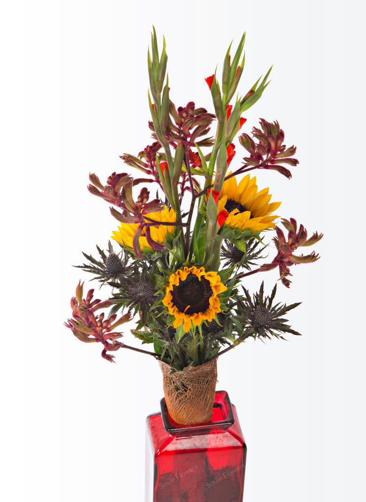 A long-stemmed bouquet with sunflowers.