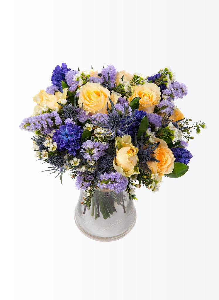 A bouquet of blue and cream coloured flowers