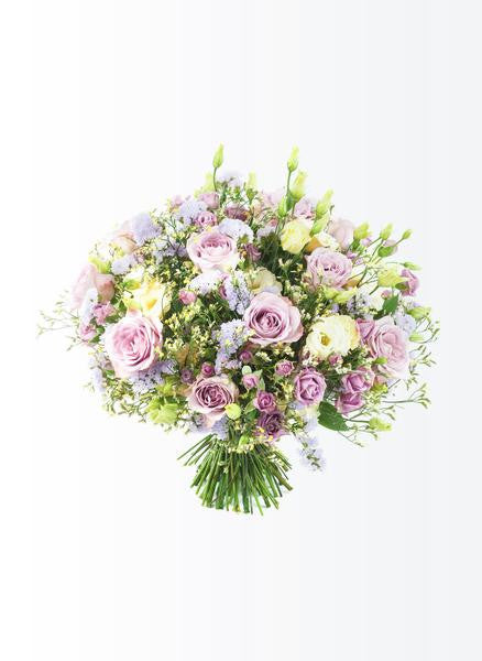 A vintage flower bouquet of roses eustomas and limonium