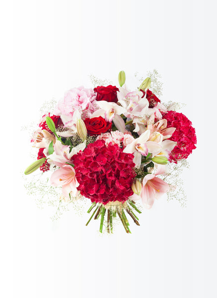 Bright flower bouquet of hydrangeas, lilies and orchids