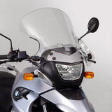 "The BMW F650GS G650GS Single Windscreen V-stream Windshield Ztechnik Z2413 Clear Tall Touring Screen 09-11 offers improved comfort and performance by giving a maximum height and width increase, along with maximum impact or scratch protection for that added piece of mind. Ideal for tall riders.  The unique cut and flair designed into the Z2413 VStream gives this screen a big advantage over stock. ZTechnik's Z2413 measures 5.00"" taller and 4.50"" wider. That's a big improvement."