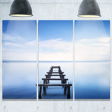 jetty remains in blue lake seascape photo canvas print PT8366