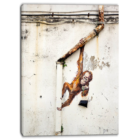 baby orangutan hanging from pipe street art canvas print PT6969