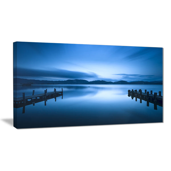 dark blue sea and piers seascape photo canvas print PT8392