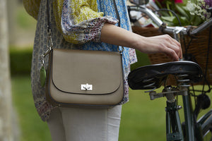 taupe beige saddle bag on model