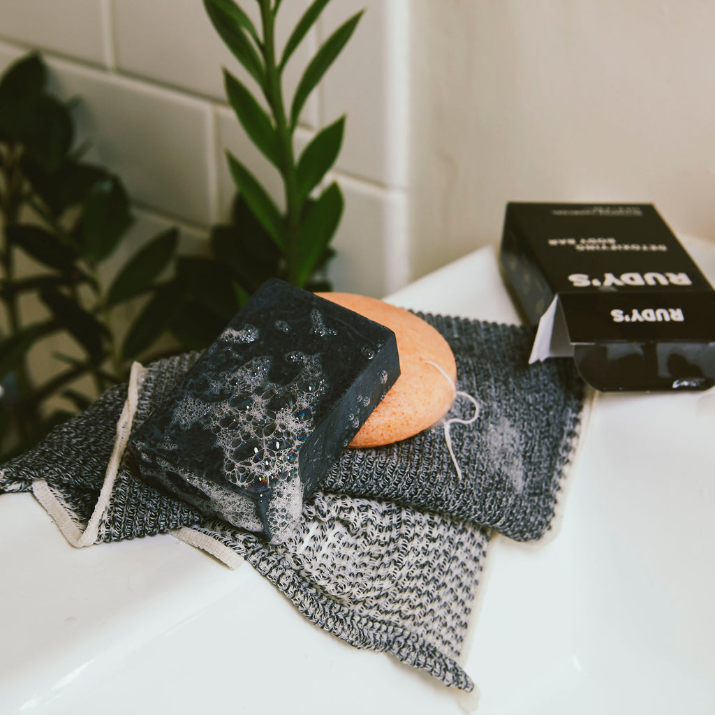 A soapy bar of Rudy's Detoxifying Body Bar with Activated Charcoal