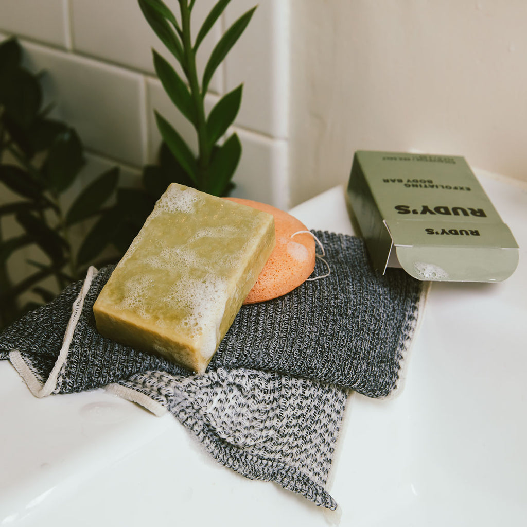 A soapy bar of Rudy's Exfoliating Body Bar