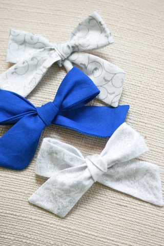 {Believe} Hand tied bows