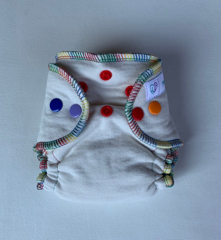 Newborn Beanpop Organic Cloth Diaper, rainbow serging & snaps.