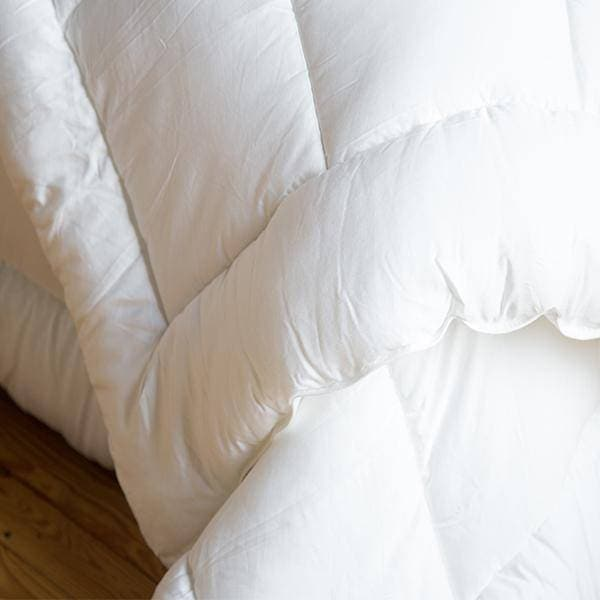 are comforters baffle down finest cozy warm with the generously light regular weight duvets comforter box white filled goose vero snow linens