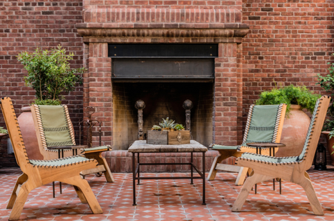 Outdoor furniture by fireplace