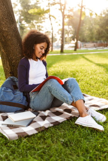 Woman in park writing goals