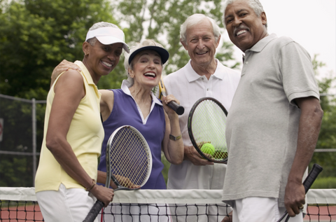 elderly couples playing tennis