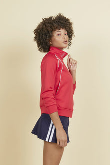 red zip up fleece with high collared neck