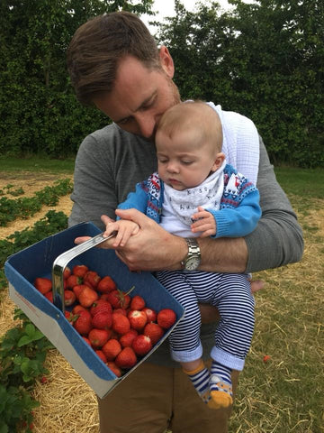 Martin and Lorenzo picking strawberries together