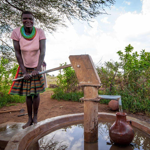 Before CAFOD World Gifts helped them restore a borehole, Longora and her two young sons had to drink river water.