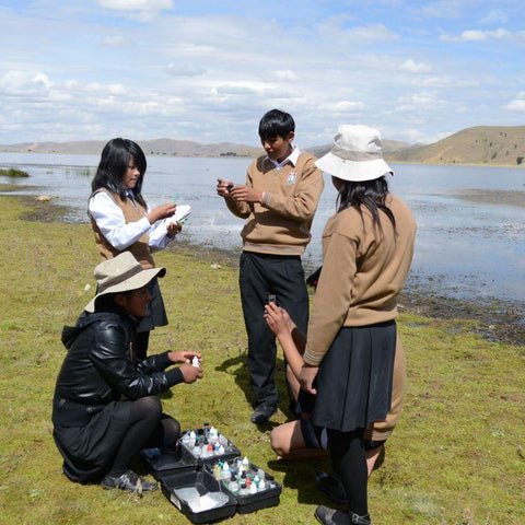 Using water testing kits, Edith and other students from her school monitor the lake.