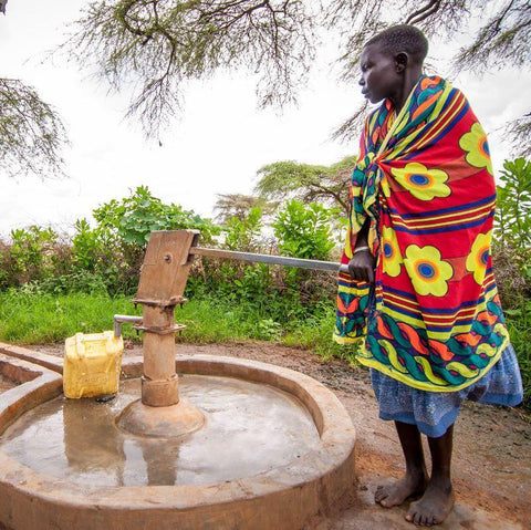 Cecelia's village borehole was fixed by a CAFOD project