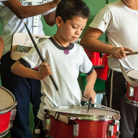 Diego loves drumming and has learnt to play thanks to these fun music classes