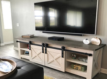 Load image into Gallery viewer, TV stand with Barn Doors, Barn Door TV Stand, Barn Door Media Stand, Media Stand with Barn Door, White TV Stand Barn Doors, White TV Stand with Barn Doors, Wooden TV stand with Barn doors, Wooden Barn door TV stand, TV stand with sliding doors, White and Grey TV Stand