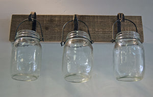 Three Canning Jars Hanging on Wood