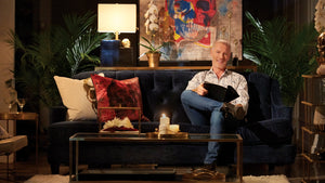 Steven Sabados sitting with products from his Taboo Studio Collection