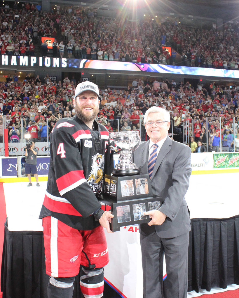 2017 Grand Rapids Griffins 8 x 10 Photo of Nathan Paetsch Accepting the Calder Cup from AHL President & CEO David Andrews