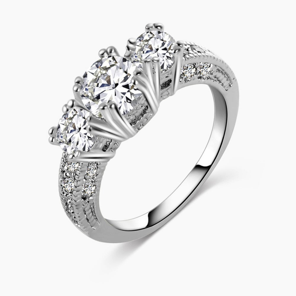 Gorgeous 3 CZ diamond ring with smaller channel set cz diamonds