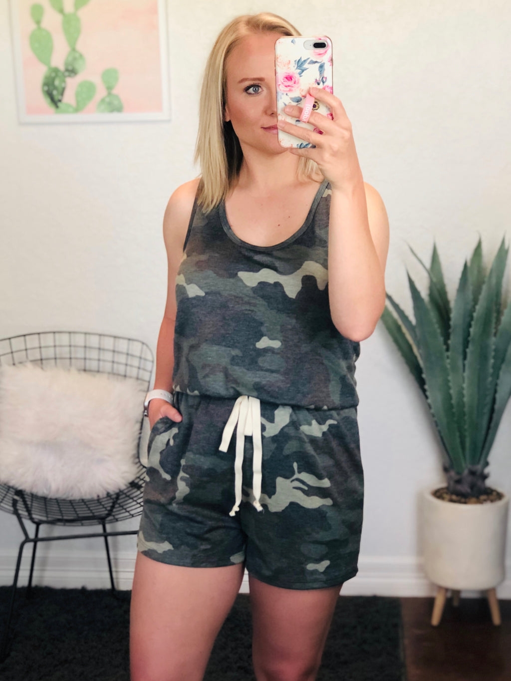 "This racerback camo romper is crazy comfy! I love the elastic waist band and faux tie detail in the front. It's perfect to throw on with some cute sneakers and a denim jacket! Model is wearing a medium for extra length in the torso.  FABRIC CONTENT:  82% Polyester / 15% Rayon / 3% Spandex  WASH INSTRUCTIONS: Hand was in cold water, do not bleach, hang dry, no iron  MODEL DETAILS: 5'4"" tall, 32 DD, 28"" waist, 36"" hips   MEASUREMENTS: (bust and hip taken across the front only)  Small:  Bust - 15.5"", Hips - 17"