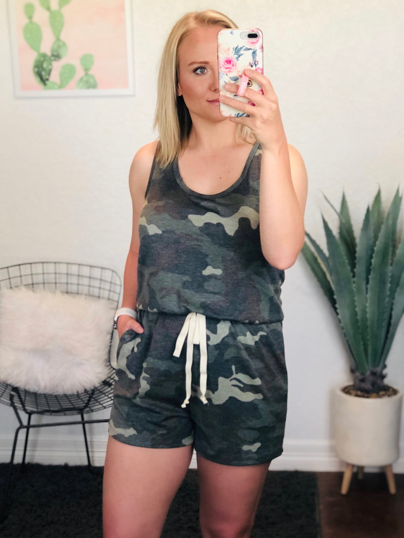 This racerback camo romper is crazy comfy! I love the elastic waist band and faux tie detail in the front. It's perfect to throw on with some cute sneakers and a denim jacket! Model is wearing a medium for extra length in the torso.  FABRIC CONTENT:  82% Polyester / 15% Rayon / 3% Spandex  WASH INSTRUCTIONS: Hand was in cold water, do not bleach, hang dry, no iron  MODEL DETAILS: 5'4