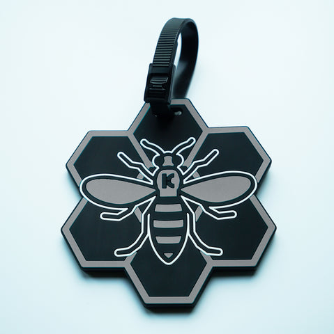 Grey MCR (Manchester) Bee Luggage Tag