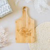 Our First Home Custom Engraved Paddle Bamboo Cutting Board