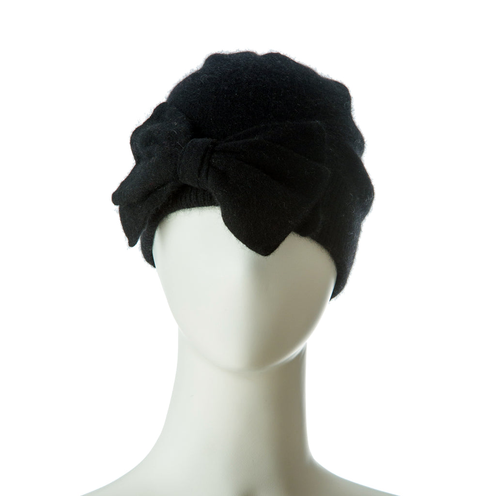 100% Mongolian cashmere designer hat with added bow shape.