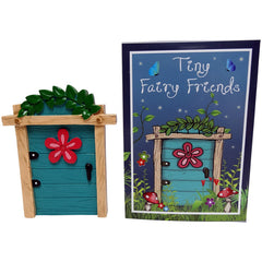 Inside blue fairy door with flower and foliage