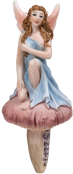 Blue fairy sitting on toadstool / mushroom for fairy gardens