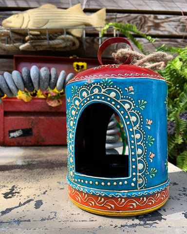 Recycled metal and hand painted bird feeder.