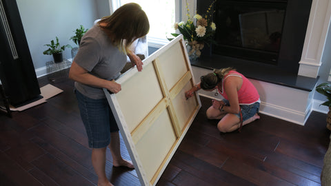 Artist Rebecca Grantham, dedicating the painting to the clients with the date, signature and personal inscription.