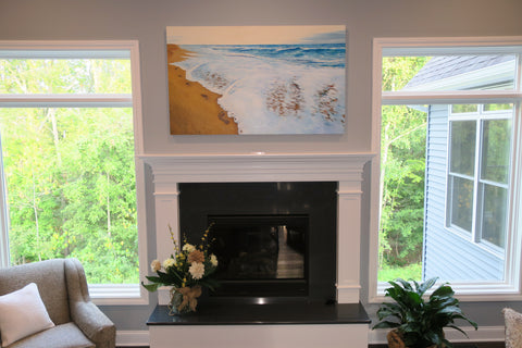 Photo of completed commissioned painting installed above the mantle in the clients new home.