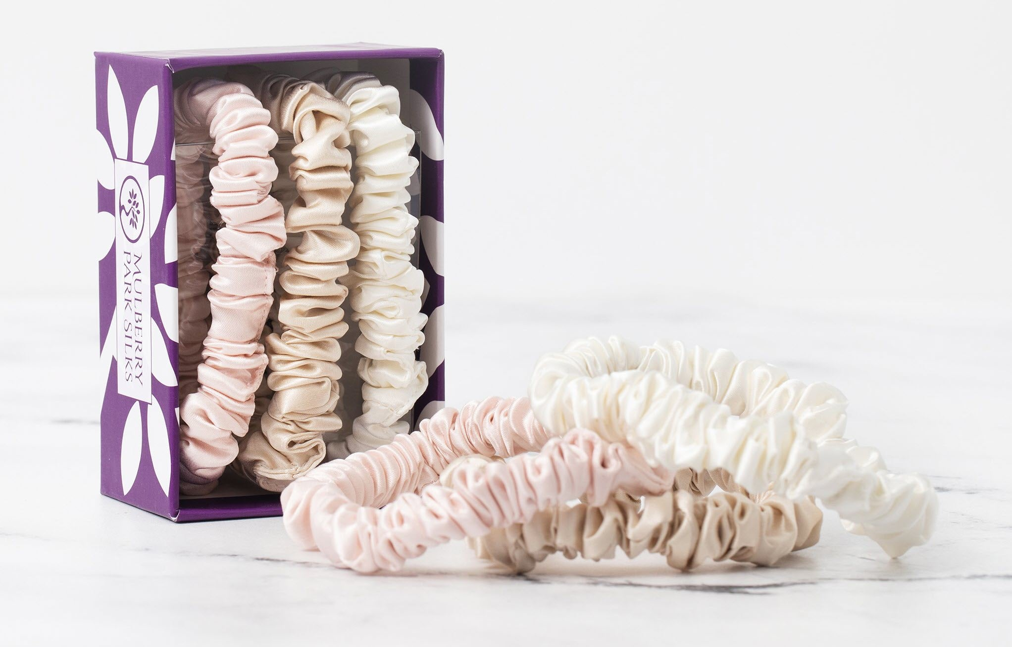 Stacked of Silk Scrunchie in Ivory, Pink and Sand color