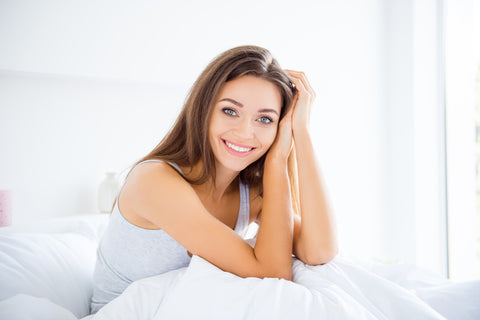 Women using a silk pillowcase with nice hair