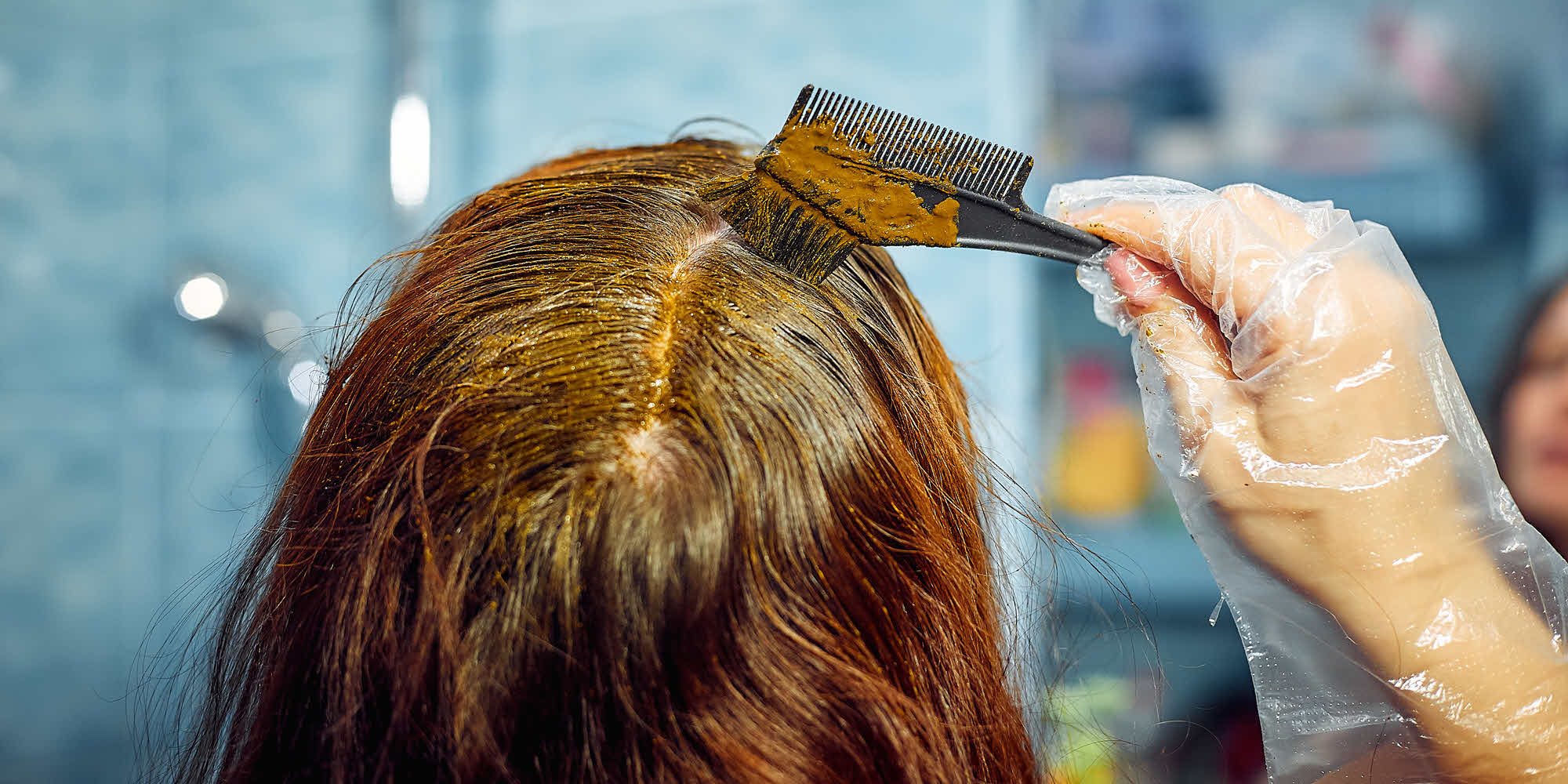 A women Color Treating her hair at home