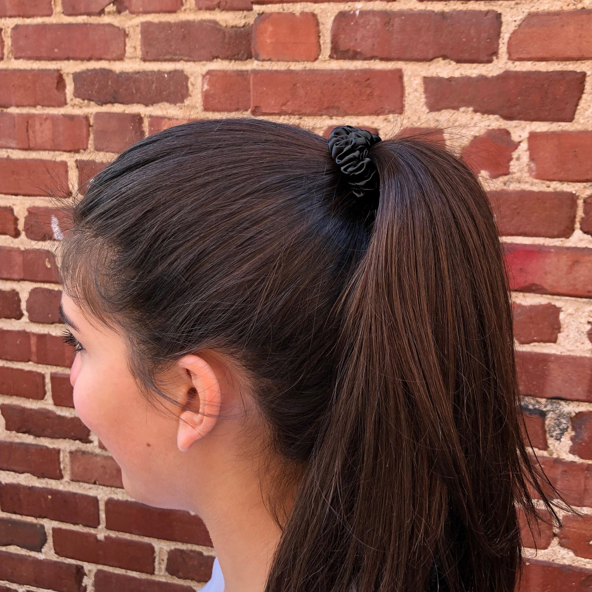 Small Midnight Black Silk Scrunchie in a womans hair