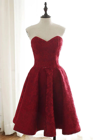 products/A_Line_strapless_knee_length_sweet_16_dress.jpg