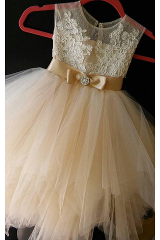 products/champagne_sleeveless_tulle_flower_girl_dress_with_bow.jpg