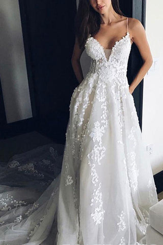 products/n74_spaghetti_staps_ivory_wedding_dress_1024x1024_dc17d0aa-fe91-4112-924c-a5b0ec4ac5e4.jpg