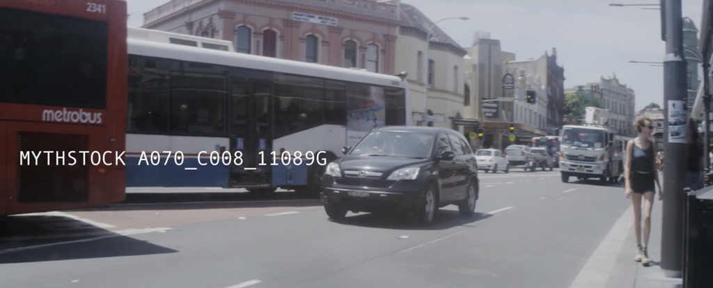 Traffic in Newtown, Sydney's inner-west on a summer's day - hand-held anamorphic shot