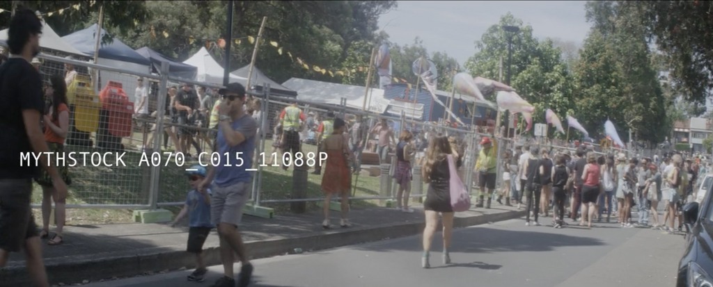 Festival-goers outside a summer music festival in Newtown, Sydney - hand-held anamorphic shot